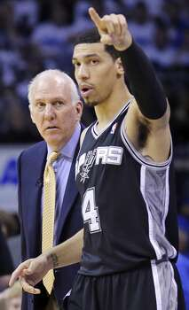 San Antonio Spurs head coach Gregg Popovich talks with Danny Green during first half action in Game 4 of the Western Conference Finals Tuesday May 27, 2014 at Chesapeake Energy Arena in Oklahoma City, OK. Photo: Edward A. Ornelas, San Antonio Express-News