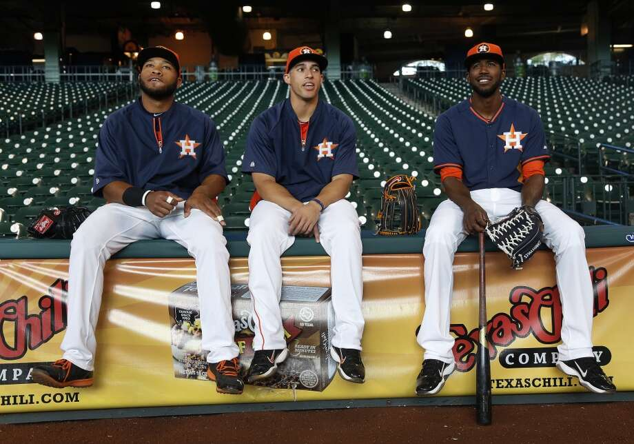 Jon Singleton, left, who was just signed and brought up from the minors chats with teammates George Springer, center, and Dexter Fowler, right during batting practice. Photo: Karen Warren, Houston Chronicle