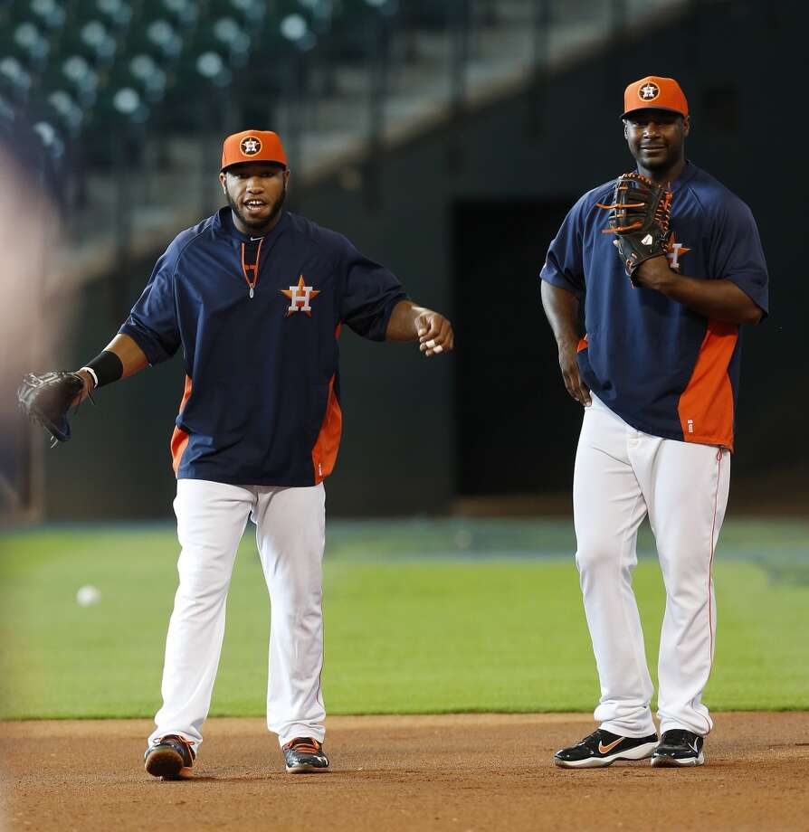 Jon Singleton, who was just signed and brought up from the minors warms up at first base with Chris Carter during batting practice. Photo: Karen Warren, Houston Chronicle