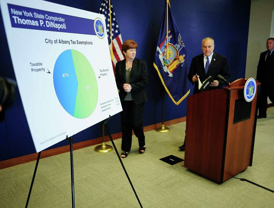 Albany Mayor Kathy Sheehan, left, and New York State Comptroller Thomas DiNapoli walk in at the start of a press conference at the State Comptroller's office on Tuesday, June 3, 2014, in Albany, N.Y.  The press conference was held to release a fiscal profile on the city of Albany.  (Paul Buckowski / Times Union) Photo: Paul Buckowski / 00027153A