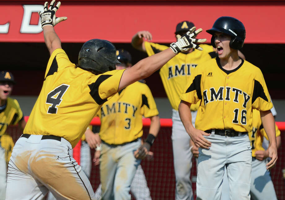 Amity's Gerald Farace, left, scores at home and celebrates, during Class LL State Baseball Tournament action against Fairfield Prep at Fairfield University in Fairfield, Conn. on Tuesday June 3, 2014. Photo: Christian Abraham / Connecticut Post