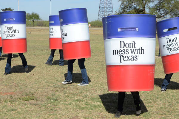 Members of the Odessa College Cheer Team dress as trash cans and dance to the Don't Mess with Texas song during a news conference to promote Texas Department of Transportation's litter clean up 'can'paign Friday, April 12, 2013 at the Petroleum Museum in Midland, Texas. (AP Photo/The Odessa American, Mark Sterkel| )