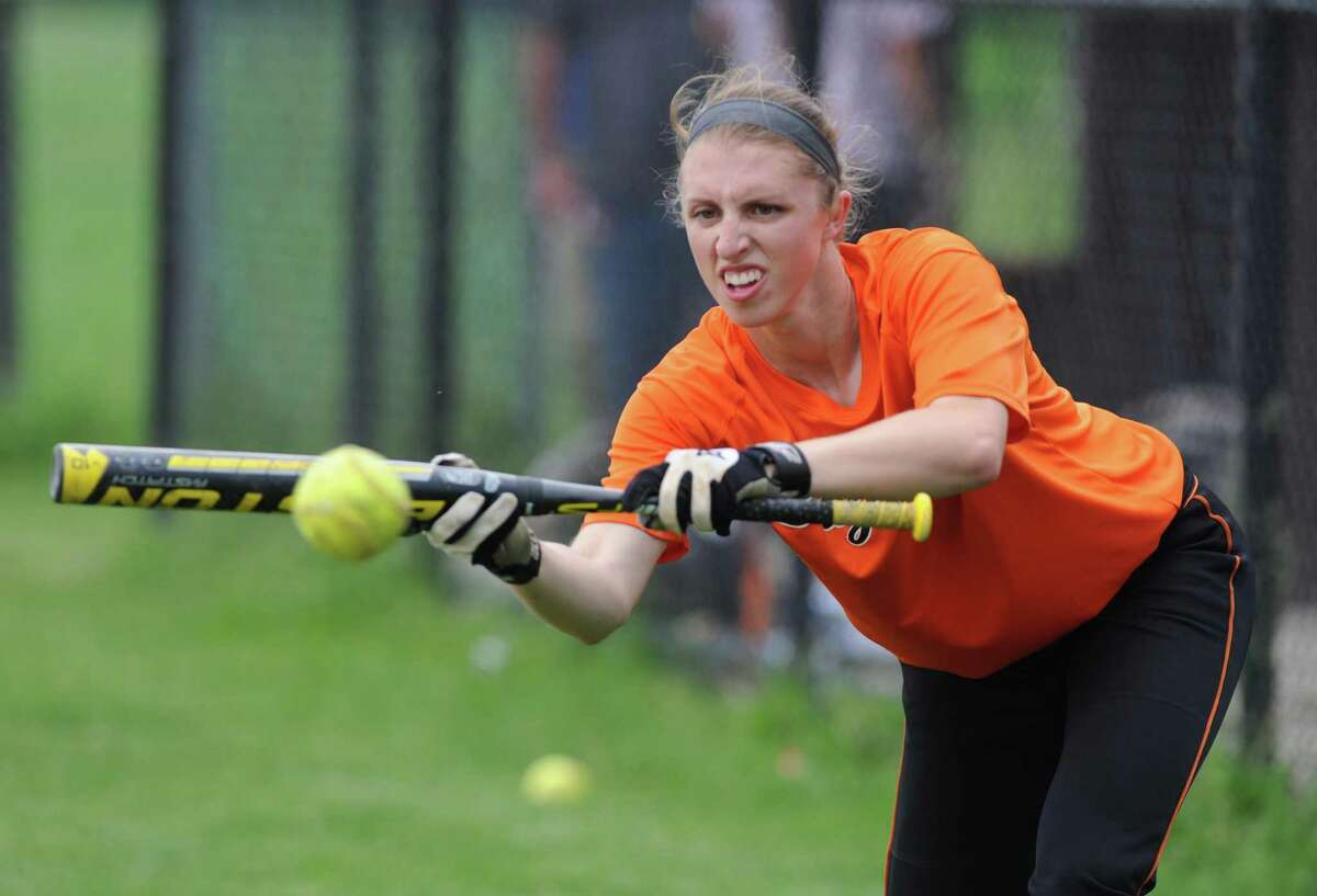 Bethlehem high School softball shortstop Carrie Maniccia practices her bunting prior to a scrimmage with Troy on Tuesday June 3, 2014 in Delmar, N.Y. (Michael P. Farrell/Times Union)