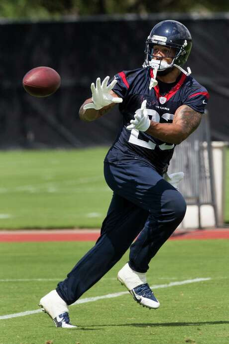 Arian Foster displays the pass-catching ability that has caught the eye of new head coach Bill O'Brien during Tuesday's OTA. Photo: Brett Coomer, Staff / © 2014 Houston Chronicle