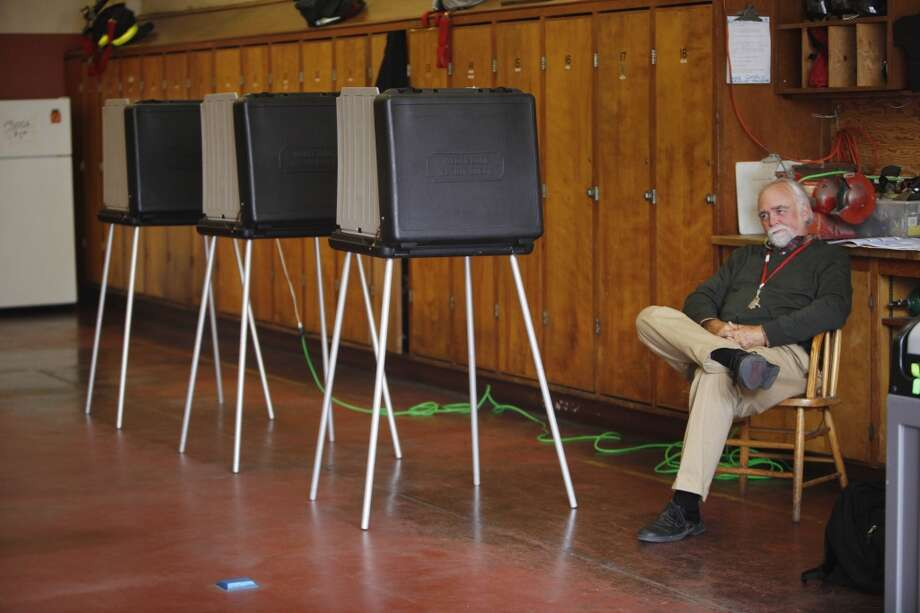 James Parke, poll worker inspector, sits by a line of voting booths while working on election day at Fire Station 23 on Tuesday June 3, 2014  in San Francisco, Calif. Photo: Lea Suzuki, The Chronicle