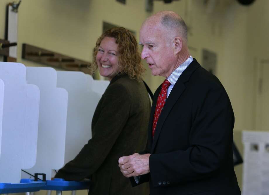 Gov. Jerry Brown chats with voters after casting his ballot at a polling place in Oakland, Calif. on Tuesday, June 3, 2014. Brown is running for reelection for a second consecutive term and will likely face either Republicans Neel Kashkari or Tim Donnelly in the November general election. Photo: Paul Chinn, The Chronicle
