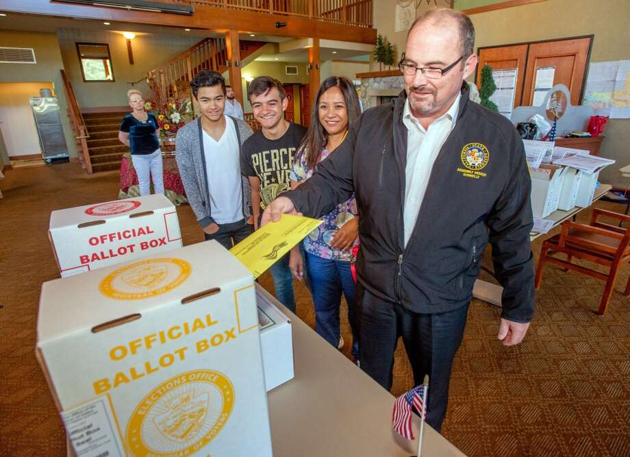 California Governor Candidate Tim Donnelly casts his vote with his family, sons Daniel, 16, left, Greg, 14, and wife Rowena during the 2014 gubernatorial election, Tuesday, June 3, 2014 at the Lake Arrowhead Country Club in Lake Arrowhead, Calif. Photo: Eric Reed, Associated Press