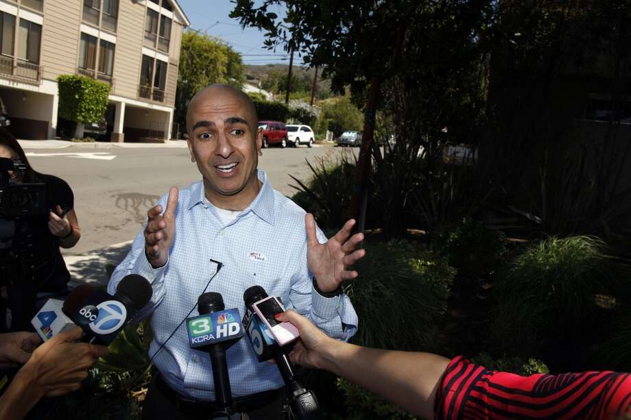 Gubernatorial candidate Neel Kashkari speaks with the media after he cast his vote at the Unitarian Universalist Fellowship in Laguna Beach, Calif., on Tuesday, June 3, 2014. Photo: Rick Loomis, McClatchy-Tribune News Service