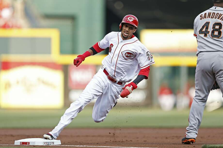 CINCINNATI, OH - JUNE 3: Billy Hamilton #6 of the Cincinnati Reds rounds third base on his way to scoring a run after a throwing error in the first inning of the game by Tim Lincecum (not pictured) of the San Francisco Giants at Great American Ball Park on June 3, 2014 in Cincinnati, Ohio. (Photo by Joe Robbins/Getty Images) Photo: Joe Robbins, Getty Images