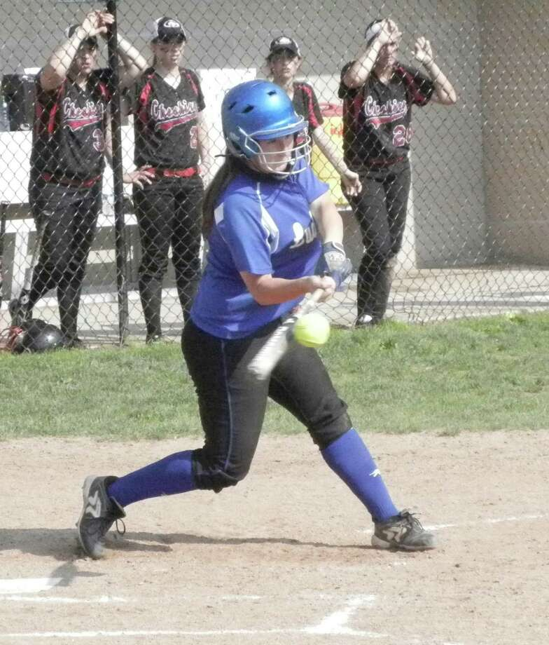 Fairfield Ludlowe junior catcher Katie DeCarlo flying out to right field in the top of the fourth inning on Tuesday, June 3 in a CIAC Class LL softball second-round game in Cheshire. The Falcons lost 3-1 and were eliminated from the playoffs with a final record of 16-7. Photo: Reid L. Walmark / Fairfield Citizen