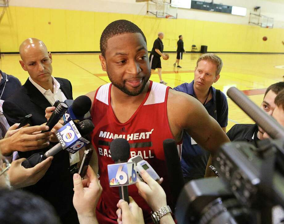 Dwyane Wade, talking with members of the media after practice Tuesday in Miami, would become the eighth player with four championships and at least one NBA Finals MVP award if the Heat beat the Spurs. Photo: Hector Gabino / McClatchy-Tribune News Service / El Nuevo Herald