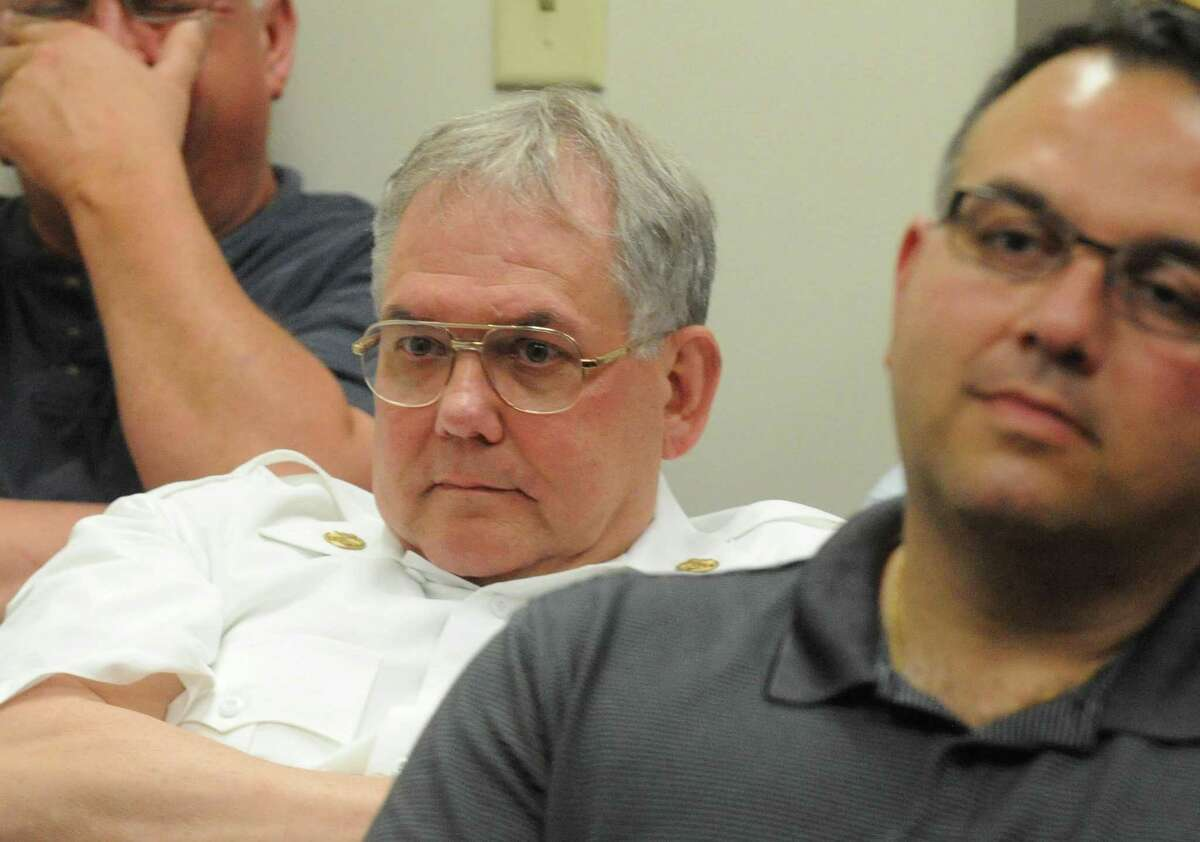 Troy Fire Chief Tom Garrett, center, listens to the Troy City Council hearing on demolished city properties on Tuesday June 3, 2014 in Troy, N.Y. (Michael P. Farrell/Times Union)