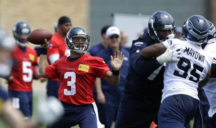 Seahawks right tackle Michael Bowie blocks defensive end Benson Mayowa as quarterback Russell Wilson prepares to pass at Seahawks OTAs. Photo: Ted S. Warren, Associated Press