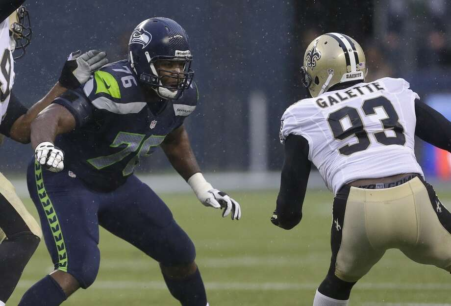 Seahawks tackle Russell Okung blocks New Orleans Saints outside linebacker Junior Galette during an NFC divisional playoff game in January. Photo: Ted S. Warren, Associated Press