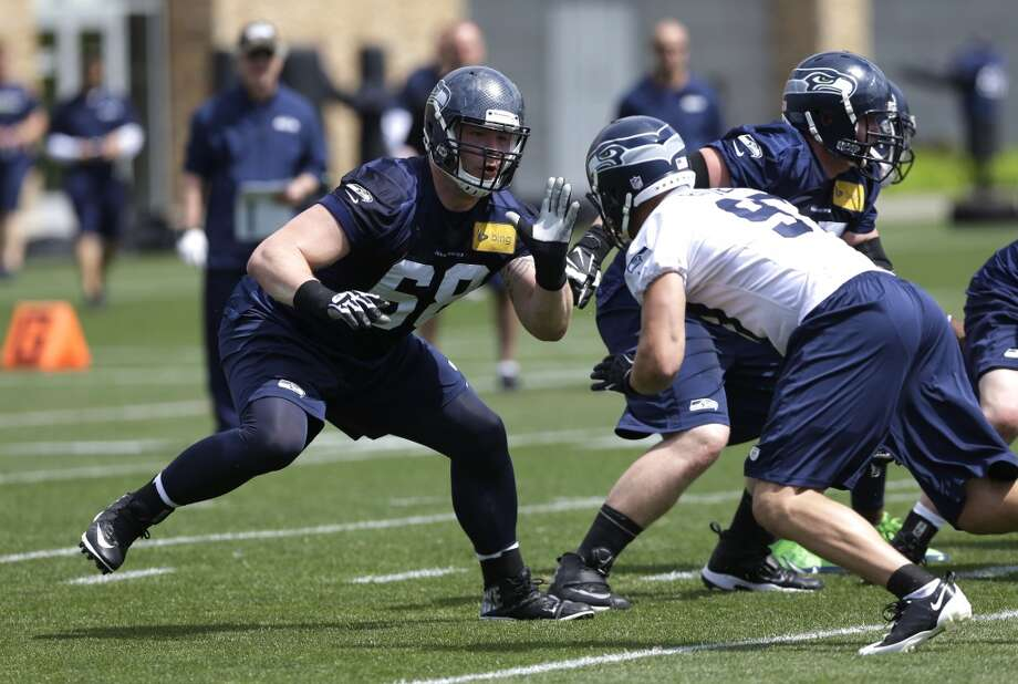 Seahawks rookie tackle Justin Britt (left) squares off against defensive end Cody Bauer during rookie minicamp. Photo: Ted S. Warren, Associated Press