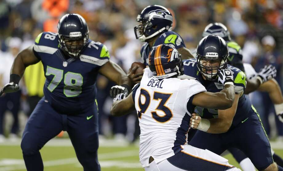 Seahawks tackle Alvin Bailey (left) in action during the 2013 preseason. Photo: Elaine Thompson, Associated Press