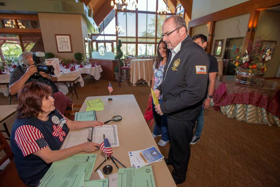 California Governor Candidate Tim Donnelly casts his vote with his family during the 2014 gubernatorial election, Tuesday, June 3, 2014 at the Lake Arrowhead Country Club in Lake Arrowhead, Calif. Photo: Eric Reed, Associated Press