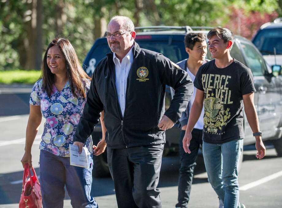 California Governor Candidate Tim Donnelly walks to cast his vote with his family during the 2014 gubernatorial election, Tuesday, June 3, 2014 at the Lake Arrowhead Country Club in Lake Arrowhead, Calif. Photo: Eric Reed, Associated Press