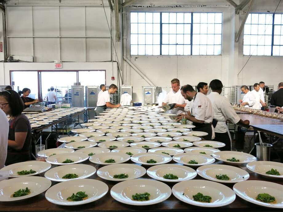 Rows up dishes being plated up for dinner at the Meals on Wheels Star Chefs & Vintners' Gala Photo: Catherine Bigelow