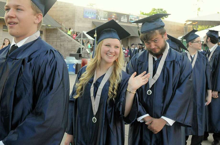 Graduate Shaylee Clardy waves to friends as she marches into the Pavilion during the College Park High School Commencement ceremony at Cynthia Mitchell Pavilion.  Photo: David Hopper, For The Chronicle / freelance