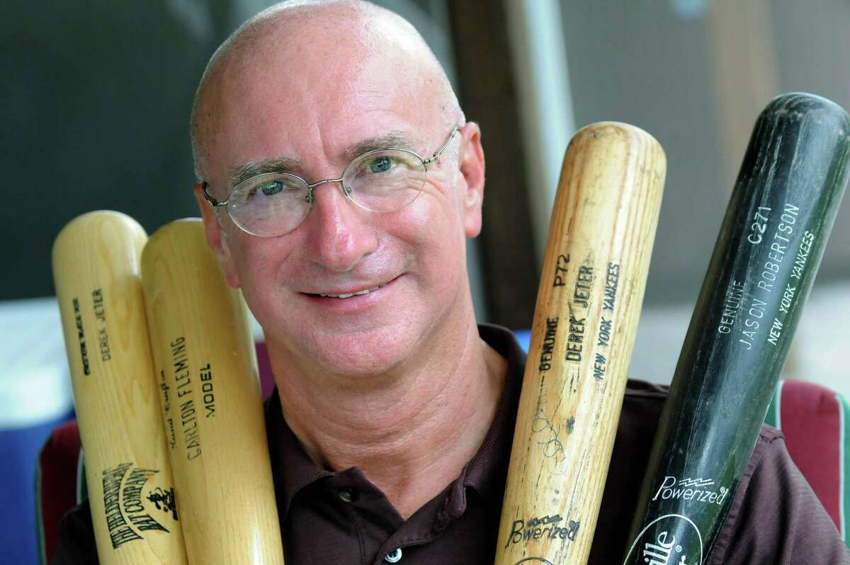 Peter Rokeach with bats used by Derek Jeter, Carlton Fleming and Jason Robertson on Tuesday, June 3, 2014, at his home in Colonie, N.Y. (Cindy Schultz / Times Union)