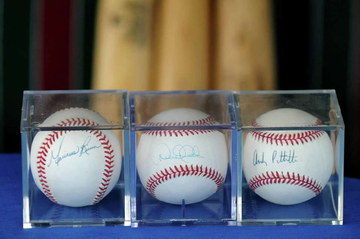 Signed baseballs from Mariano Rivera, Derek Jeter and Andy Pettitte owned by Peter Rokeach on Tuesday, June 3, 2014, at his home in Colonie, N.Y. (Cindy Schultz / Times Union)