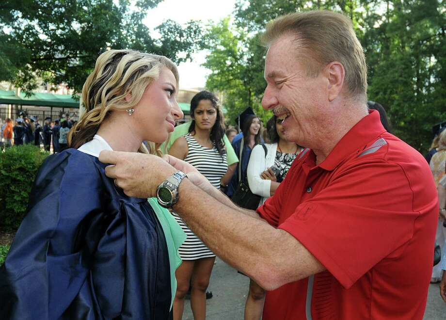 Steve Thomas fixes his daughter's, Savannah, collar during the College Park High School Commencement ceremony at Cynthia Mitchell Pavilion.  Photo: David Hopper, For The Chronicle / freelance