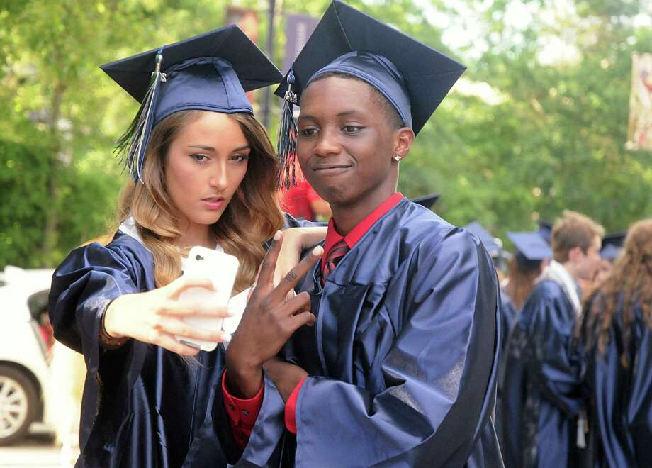 "Graduates Shadlene Knoght and Thomas Ward share one last ""selfie"" during the College Park High School Commencement ceremony at Cynthia Mitchell Pavilion.  Photo: David Hopper, For The Chronicle / freelance"