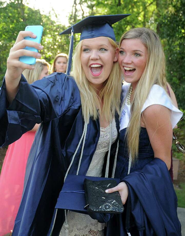 "Graduates Lauren Burgess and Aubrey Hanson enjoy a ""selfie"" during the College Park High School Commencement ceremony at Cynthia Mitchell Pavilion.  Photo: David Hopper, For The Chronicle / freelance"
