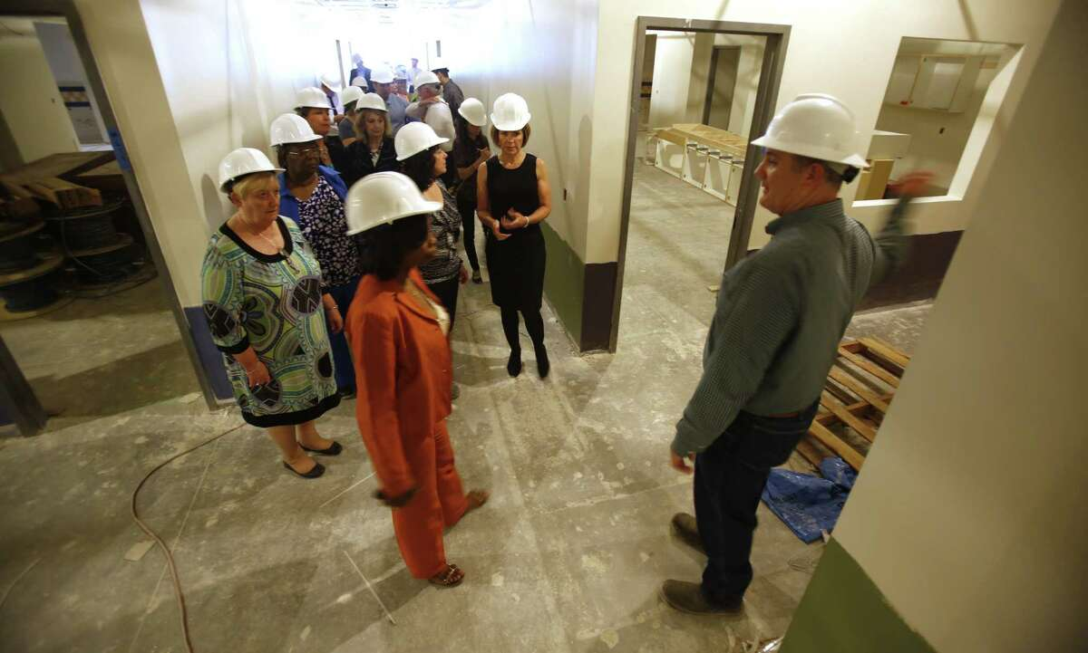 Councilwoman Ivy Taylor (second from left) is part of a delegation touring the Pre-K 4 SA center being built on the West Side.