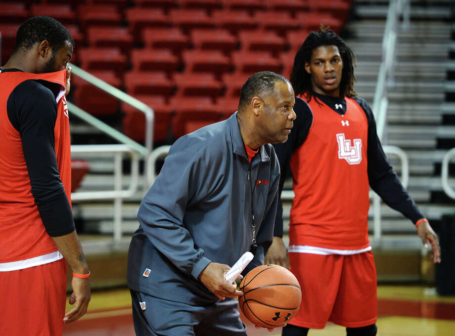 Tic Price picks up a ball as he advises players mid-drill during practice Wednesday afternoon. Lamar University has position Tic Price as the interim head coach for the men's basketball team. Photo taken Wednesday, 2/19/14 Jake Daniels/@JakeD_in_SETX Photo: Jake Daniels / ©2013 The Beaumont Enterprise/Jake Daniels