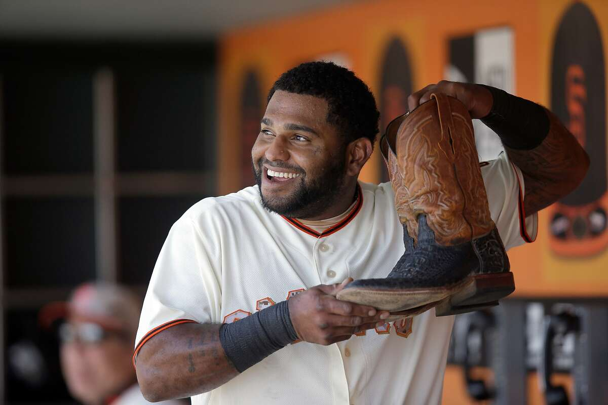 SAN FRANCISCO, CA - MAY 26: Pablo Sandoval #48 of the San Francisco Giants holds up a pair of Madison Bumgarner's #40 cowboy boots in the dugout after hitting a home run in the fourth inning against the Chicago Cubs at AT&T Park on May 26, 2014 in San Francisco, California. (Photo by Ezra Shaw/Getty Images)