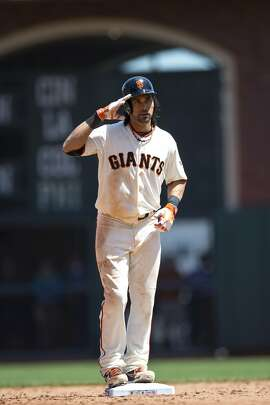 SAN FRANCISCO, CA - MAY 28:  Angel Pagan #16 of the San Francisco Giants celebrates after hitting a double against the Chicago Cubs during the sixth inning at AT&T Park on May 28, 2014 in San Francisco, California.  (Photo by Jason O. Watson/Getty Images)