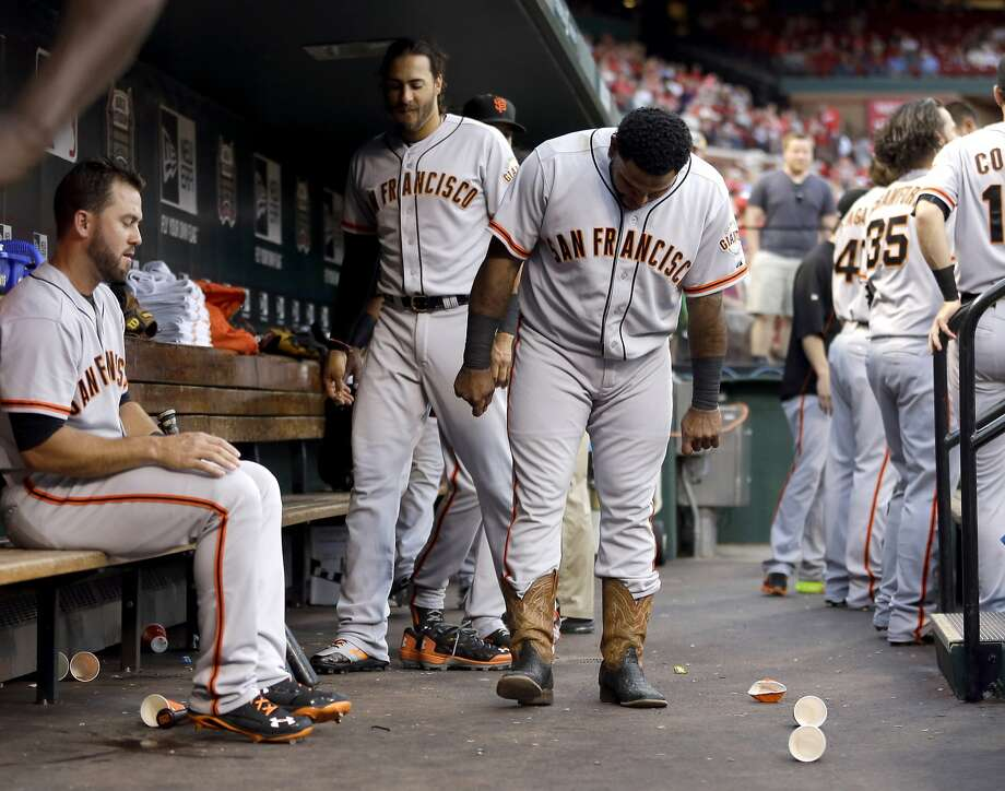 The Giants' dugout, especially with Pablo Sandoval sporting cowboy boots, is usually loose and happy. Photo: Jeff Roberson, Associated Press