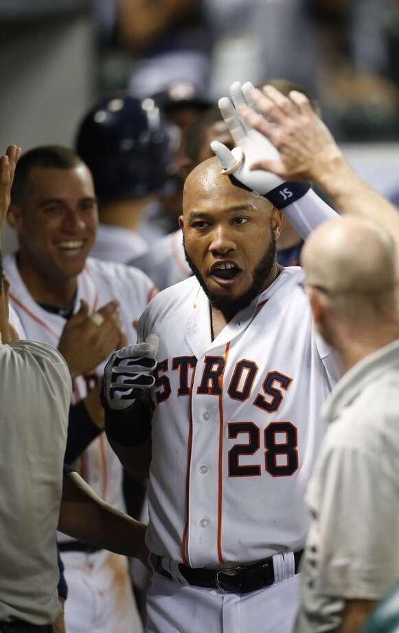 Astros first baseman Jon Singleton (28) celebrates hitting his first major league home run. Photo: Karen Warren, Houston Chronicle