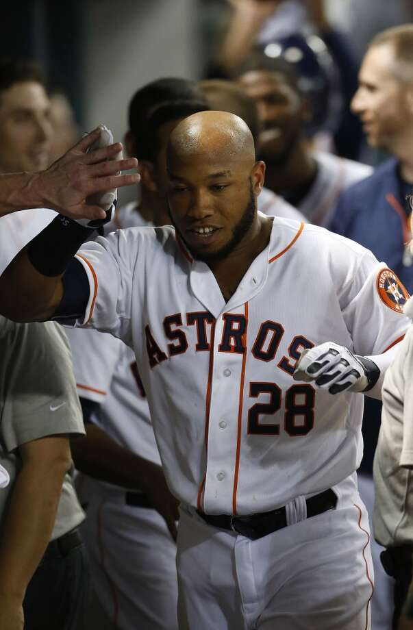 Astros first baseman Jon Singleton (28) celebrates hitting his first major league home run. Photo: Karen Warren, Houston Chronicle