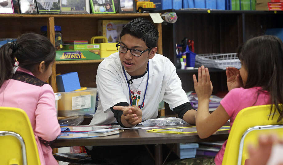 Nicholas Alderete, one of the award winners in the national writing contest, works with third-graders at Kindred Elementary. Photo: Photos By Tom Reel / San Antonio Express-News / San Antonio Express-News