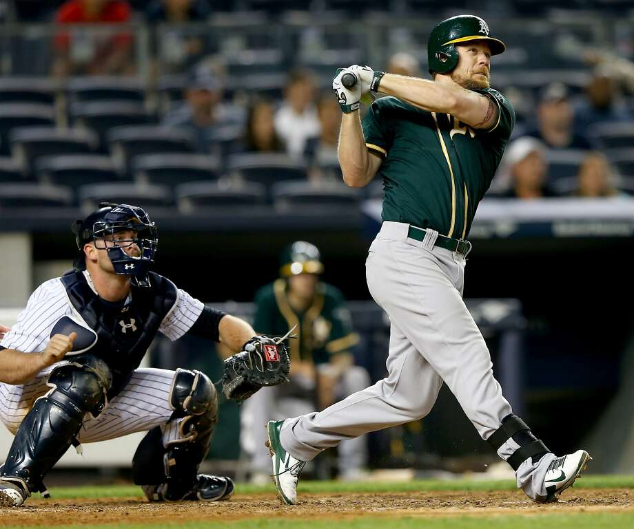 Brandon Moss' long homer in the 10th inning, his second of the game, helped the A's to their sixth win in eight games. Photo: Elsa, Getty Images