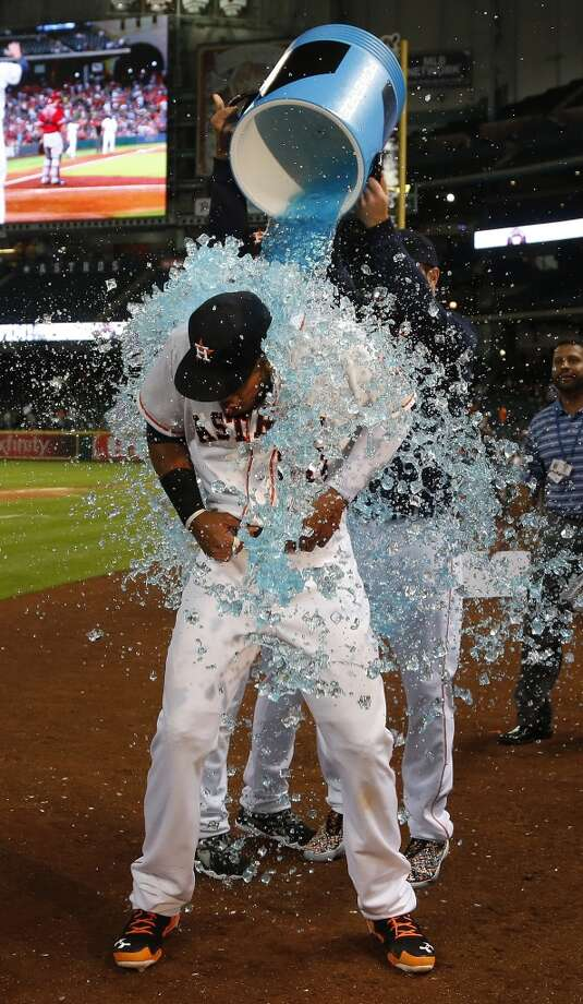 Houston Astros first baseman Jon Singleton (28) gets dunked with Powerade by teammates Jarred Cosart and Dallas Keuchel during his interview after the Astros win and Singleton homered in his first major league game after an MLB game at Minute Maid Park, Tuesday, June 3, 2014, in Houston.  ( Karen Warren / Houston Chronicle  ) Photo: Houston Chronicle
