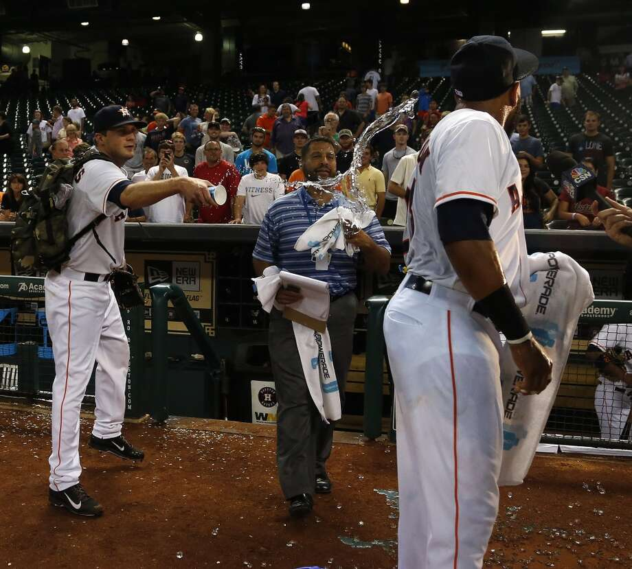 Houston Astros first baseman Jon Singleton (28) gets a cup of water thrown on him by teammate Paul Clemens (56) during his interview after the Astros win and Singleton homered in his first major league game after an MLB game at Minute Maid Park, Tuesday, June 3, 2014, in Houston.  ( Karen Warren / Houston Chronicle  ) Photo: Houston Chronicle