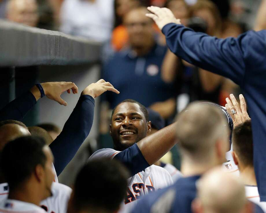 Chris Carter gets a kick out of doubling the Astros' pleasure with an eighth-inning homer that followed a blast by Jon Singleton. Photo: Karen Warren, Staff / © 2014 Houston Chronicle