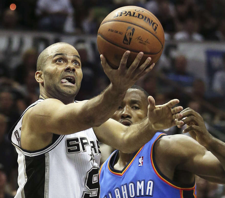 Tony Parker, beating Serge Ibaka to the basket last Thursday, all but said he was ready to play Game 1 of the NBA Finals. Photo: Tom Reel / San Antonio Express-News