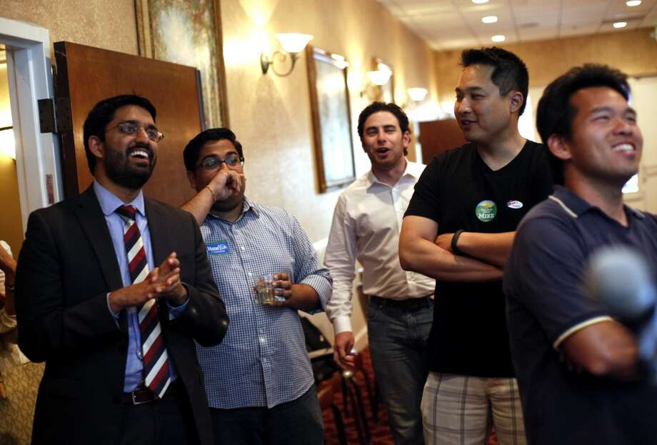 From left, communications director Vivek Kembaiyan, Vedant Patel, Ryan Simon, Edwin Tan, and John Quach watch election results come in at Congressman Mike Honda's election party at Massimo's in Fremont, Calif., on Tuesday, June 3, 2014. Photo: Sarah Rice, Special To The Chronicle