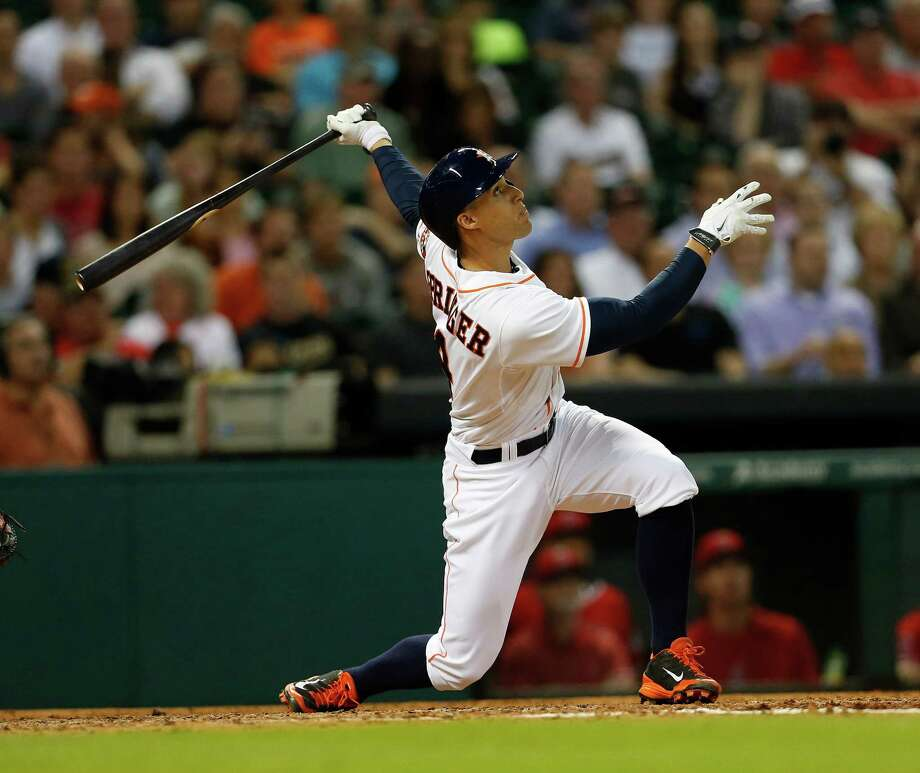 "George Springer, above, is no longer the only big-swinging rookie in the lineup with the arrival of Jon Singleton. Says Springer: ""Get your popcorn ready."" Photo: Karen Warren, Staff / © 2014 Houston Chronicle"