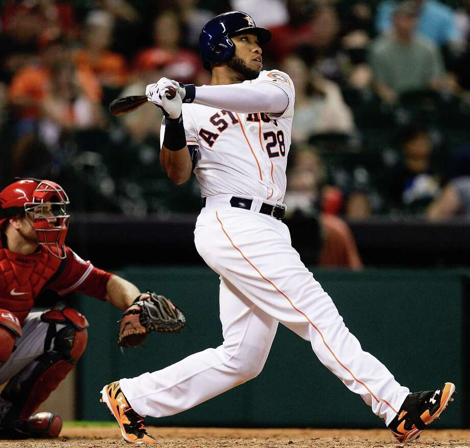 Highly touted Astros prospect Jon Singleton, playing in his first major league game, follows through on an eighth-inning home run at Minute Maid Park. He also drove in a run with a walk. Photo: Bob Levey / Associated Press / FR156786 AP