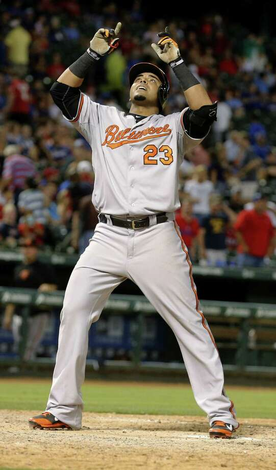 Former Ranger Nelson Cruz celebrates his three-run blast in the eighth inning for the Orioles in Arlington. Baltimore scored six in the frame. Photo: Sharon Ellman / Associated Press / FR170032 AP