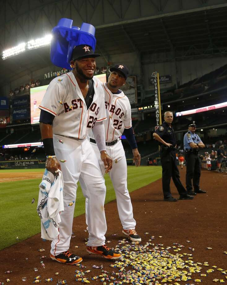 Houston Astros first baseman Jon Singleton (28) is dunked with bubble gum by Carlos Corporan (22) after the Astros win and Singleton homered in his first major league game after an MLB game at Minute Maid Park, Tuesday, June 3, 2014, in Houston.  ( Karen Warren / Houston Chronicle  ) Photo: Houston Chronicle