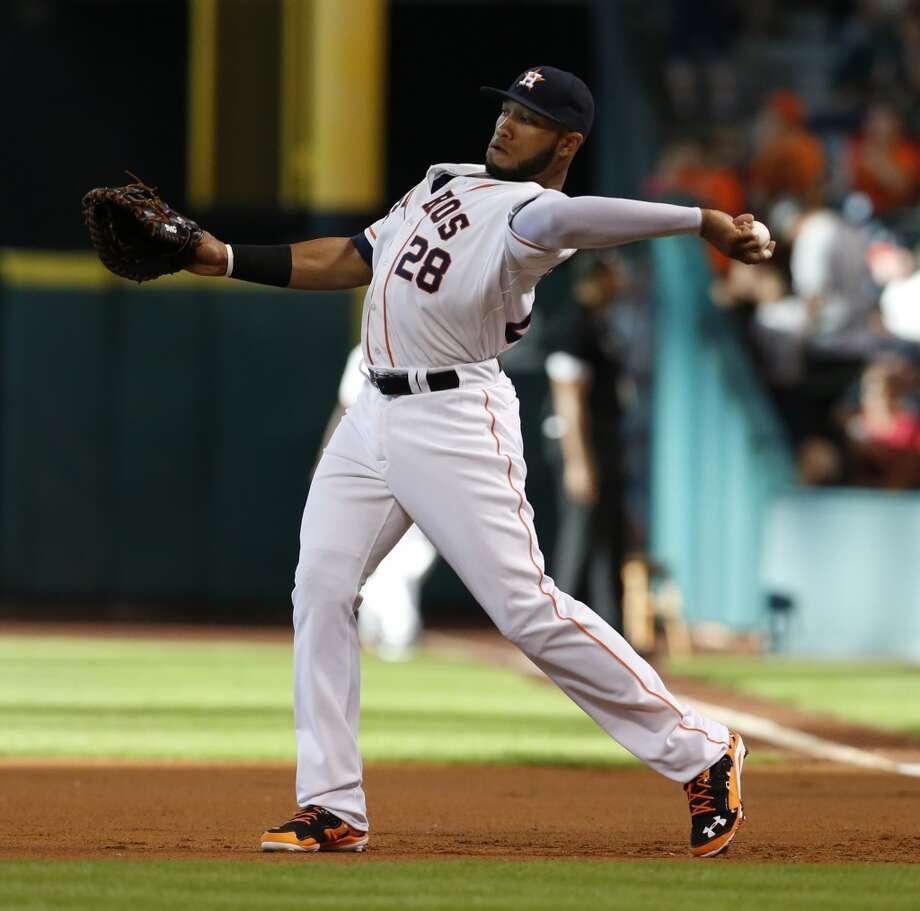 Astros first baseman Jon Singleton (28) warms up. Photo: Karen Warren, Houston Chronicle