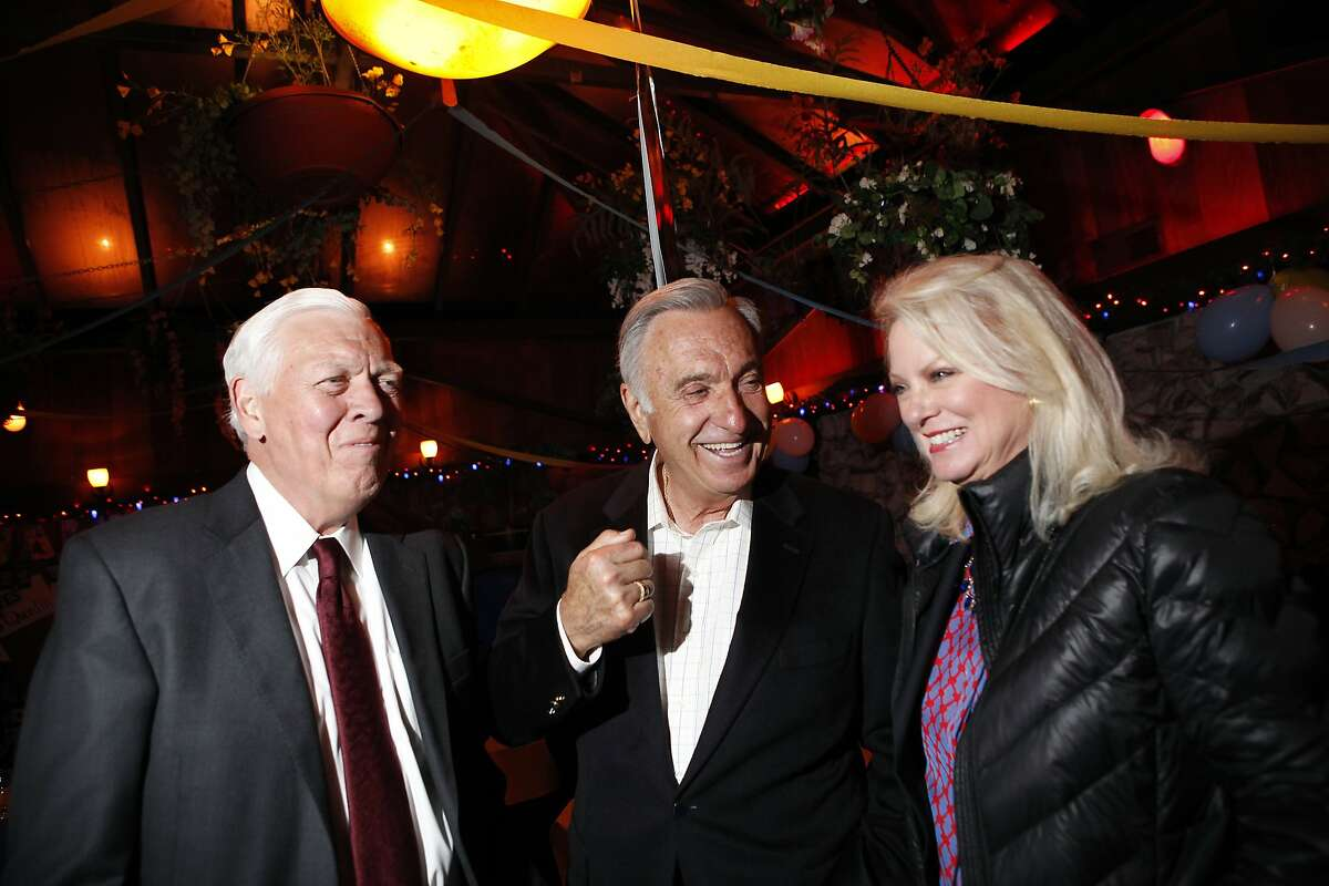 Former San Francisco Mayor Art Agnos, center, talks with Bob and Chandra Friese of San Francisco Beautiful as supporters of Proposition B gather for a party at Sinbad's Restaurant on Pier 2 in San Francisco, CA, Tuesday June 3, 2014.