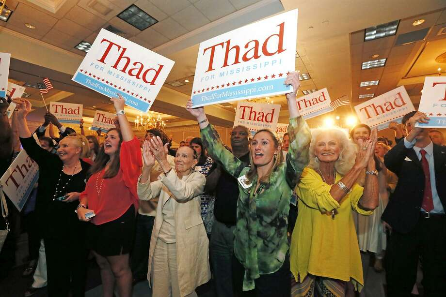 Supporters of six-term Republican Sen. Thad Cochran gather in Jackson, Miss., on election night. Cochran's camp told supporters the race appeared to be headed for a runoff. Photo: Rogelio V. Solis, Associated Press